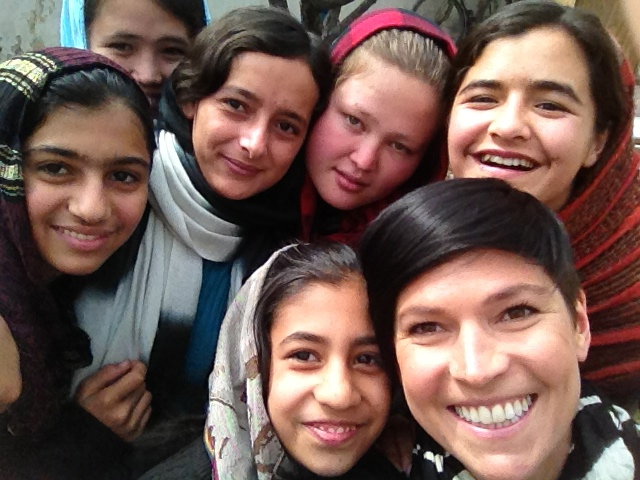 Stephanie with some of the girls she volunteered to teach on weekends during her post in Afghanistan. The girls were orphaned or otherwise affected by war. Kabul, 2012.