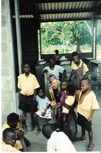 Stephanie on her first trip to Africa, with some of the students she volunteered to help in rural Ghana, 2002