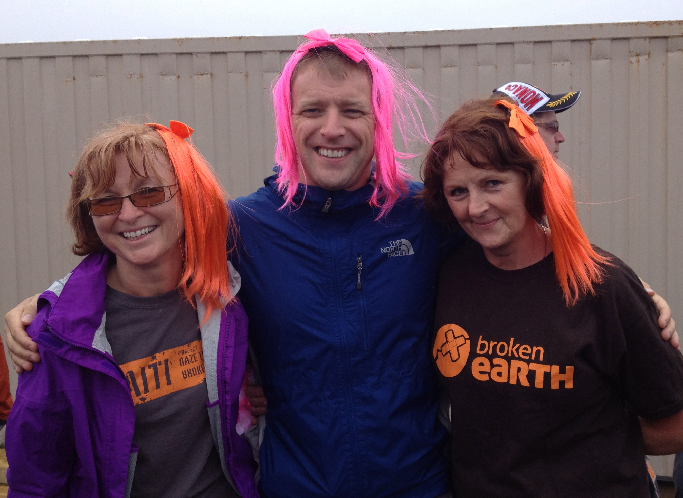 Andrew (centre) with fellow Team Broken Earth members at a rowing fundraiser for breast cancer research, St. John's, N.L.