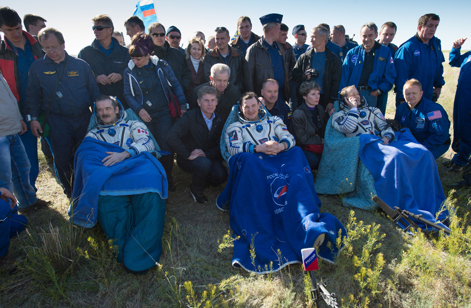 Front, from left: Chris, cosmonaut Roman Romanenko and NASA astronaut Tom Marshburn, moments after being pulled from the Soyuz rocket, Kazakhstan, May 2013. Photo: NASA