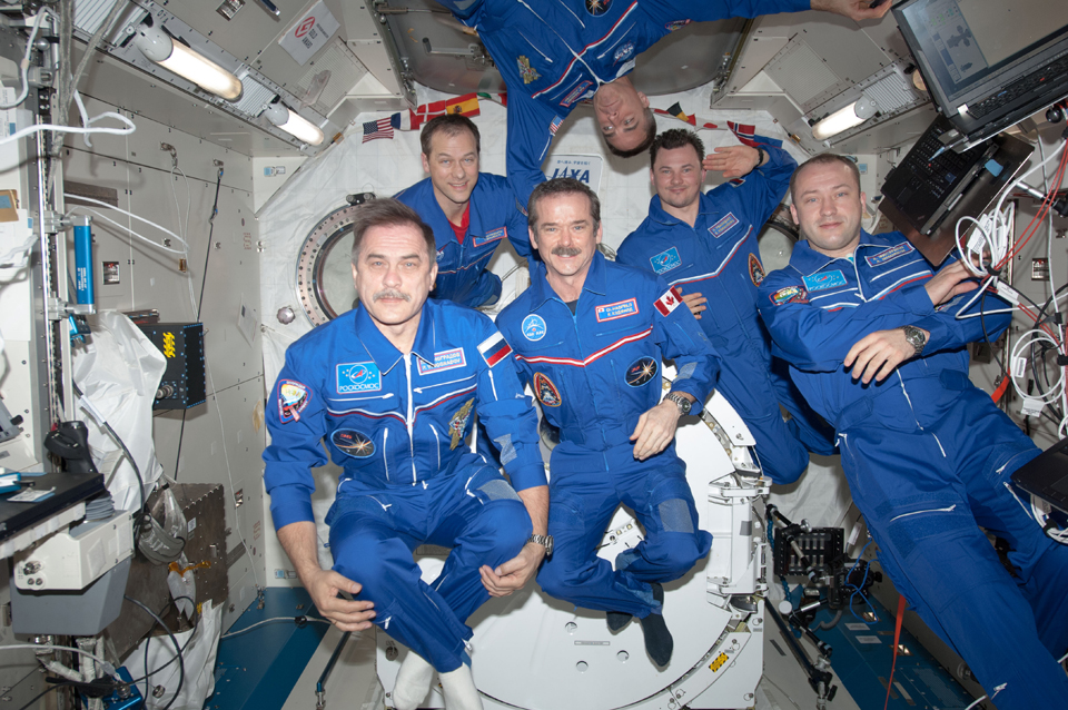 Chris (front, centre) with the Expedition 35 crew in the Kibo laboratory aboard the ISS, April 2013. Photo: NASA