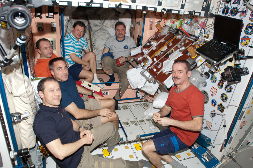 Chris (front right) and the Expedition 35 crew in the unity node aboard the ISS, April 2013. Photo: NASA
