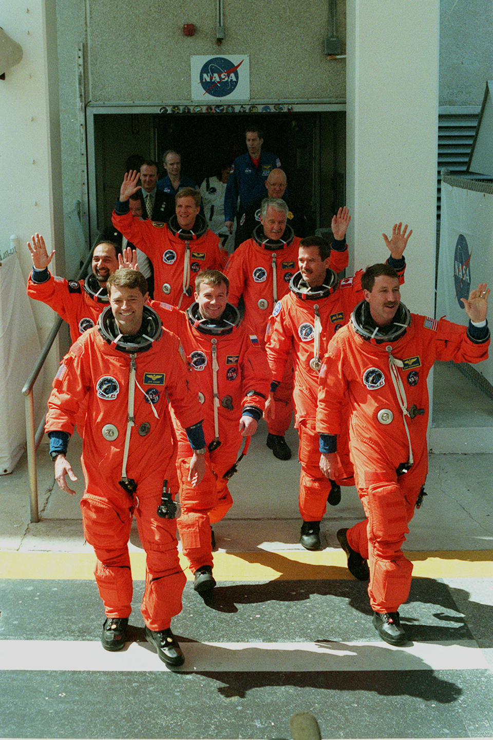 Chris (right, second from front) and the STS-100 crew prepare to launch for an 11-day mission to the ISS, 2001. Photo: NASA