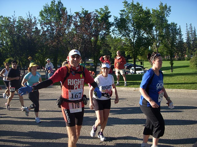 Running the Queen City Marathon with Sue at his side, Regina, Sask., September 2005