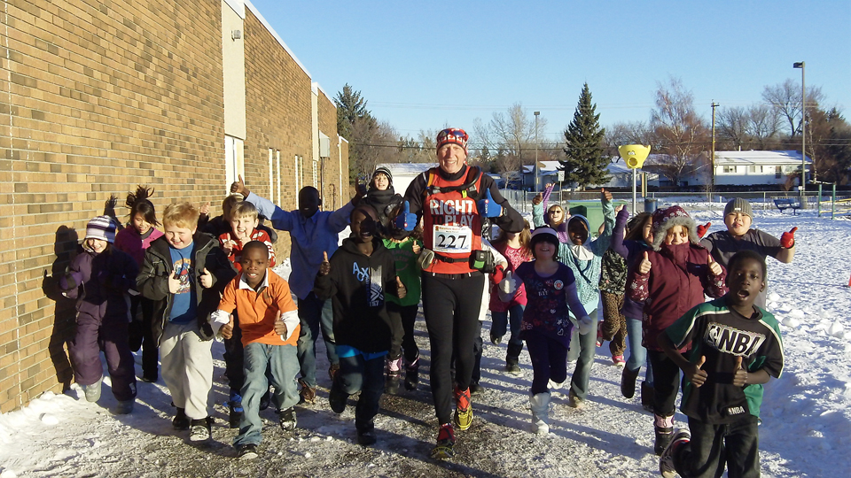 Running with students from West Dover Elementary School during Marathon Quest 250, Calgary, Alta., 2010