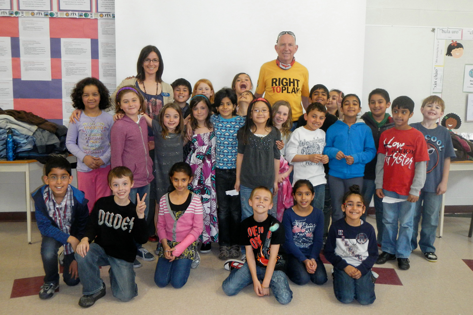 Martin (back, centre) visiting children at Prairie Waters Elementary School during Marathon Quest 250, Chestermere, Alberta, 2010