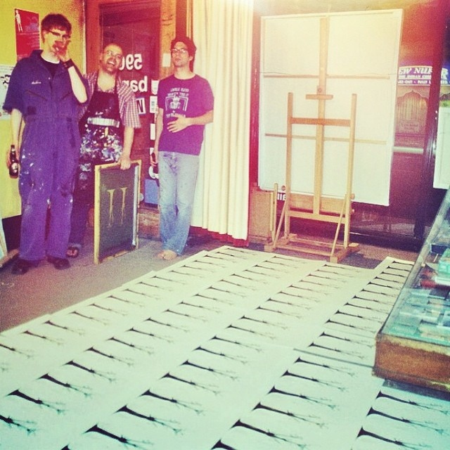 Rolf Klausener (right) silkscreening the 1st edition of 'The Pink Ghosts,' May 2004
