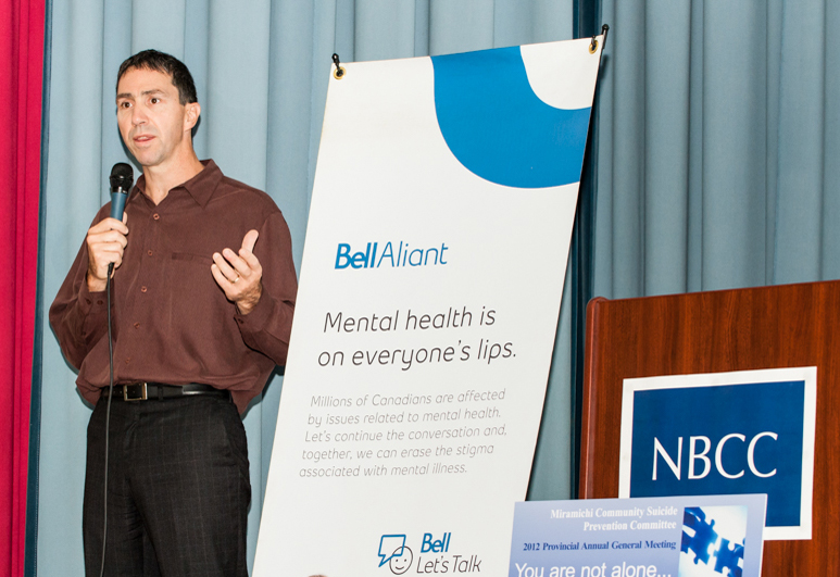 Delivering a Collateral Damage talk at New Brunswick Community College, Fredericton, N.B., 2012