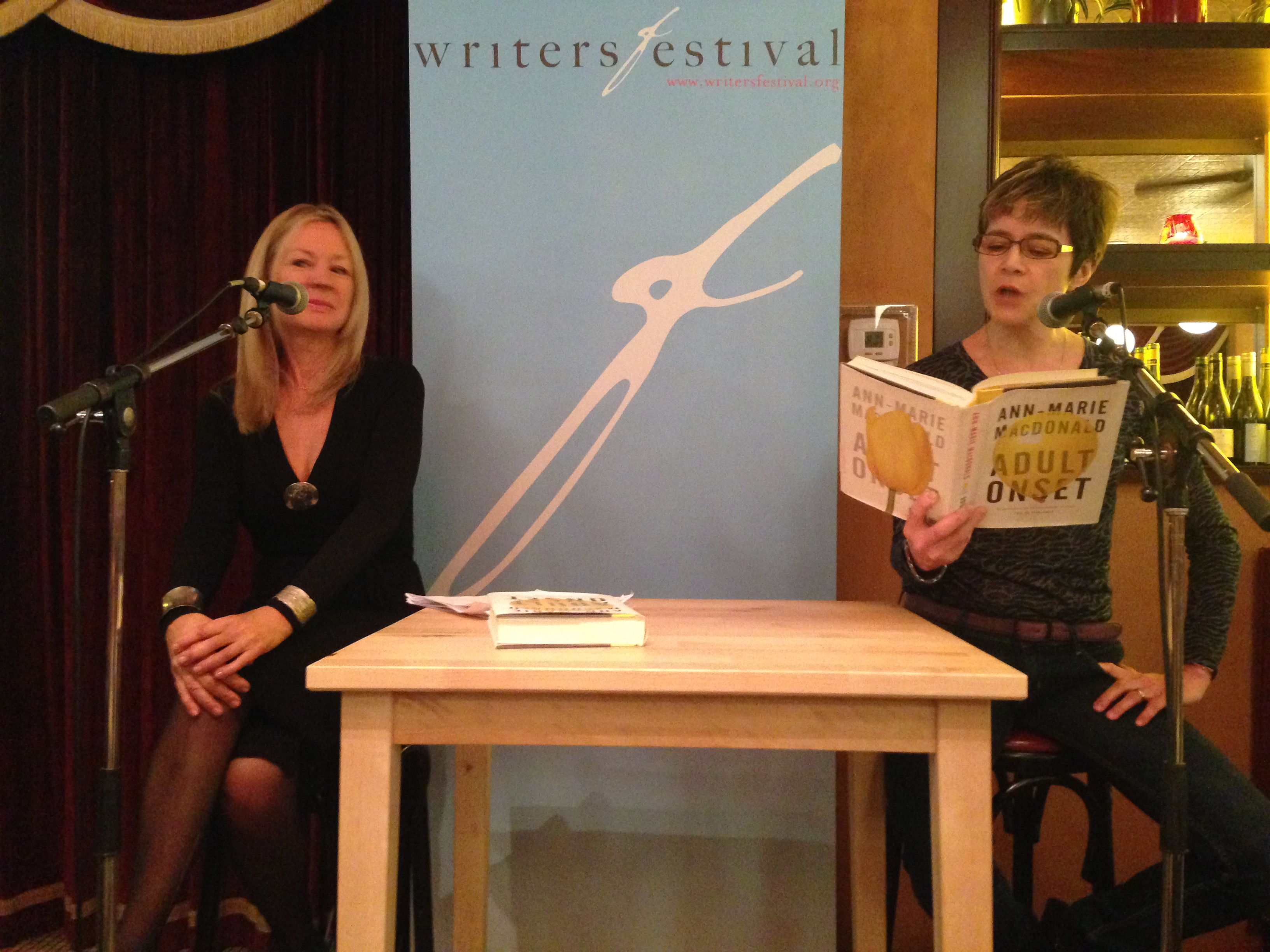 Ann-Marie (right) reading from 'Adult Onset' at the Ottawa International Writers Festival, with CBC's Sandra Abma, November 2014