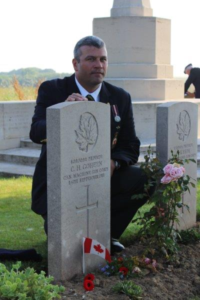 Behind the tomb of his great uncle Charles H. Goheen, killed in action September 22, 1918; July 2013