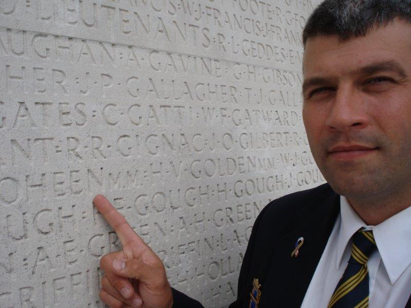 """At one of the panels of the missing at Vimy Memorial, identifying his relative Walter William Goheen, one of 11,000 Canadians """"missing presumed killed,"""" France, July 2011"""