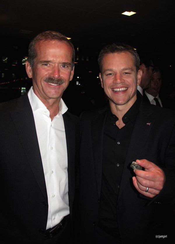 "Chris and Matt Damon (holding a piece of Mars from the ROM) at the TIFF premiere of ""The Martian,"" Toronto, Ont., September 2015"