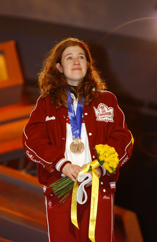 On the podium at the 2002 Winter Olympics for her bronze medal in the women's 5000m speed skating; Photo: Doug Pensinger/Getty Images