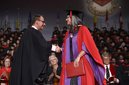 Shawn Brixey, Dean of York's School of the Arts, Media, Performance & Design, congratulates Jill on her Honorary Doctorate of Letters, June 2016, Toronto, Ont.