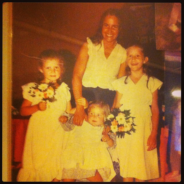 With her mother and elder sisters at a family wedding