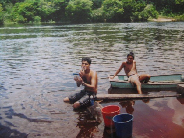 Rohit shaves by the water on the Demarara River, Guyana 2002