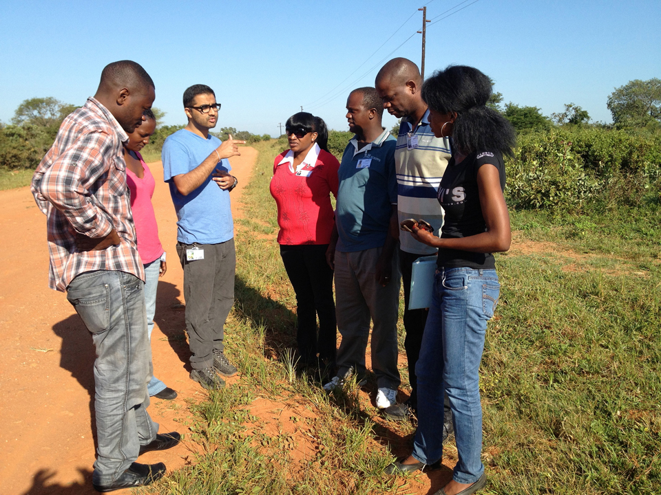 Rohit (second from left) briefs his local field research team in Zambia